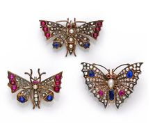 Three antique diamond and gem-set butterfly brooches, circa 1890 each of openwork design, the bodies set with pearls, the wings of rose-cut diamonds, circular-cut sapphires and rubies; one with French assay mark; mounted in silver and gold. (pearls untested)