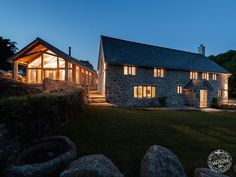 Contemporary Timber Framed Barn Extension on Traditional Farmhouse. Frame by Carpenter Oak Ltd