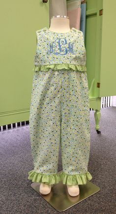 """This is a Children's Corner """"Paulie"""" for my niece Allis.  I added the ruffle at the waist instead of the sash called for in the pattern instructions.  The monogram is """"Elegant Monogram"""" from Applique Corner. LOVE how beautifully it sews out.  I'm using it for everyting!"""