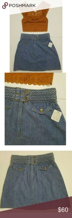 Free People High-Waisted Denim Skirt New W/Tags -- Free people jean skirt with braided waistband, double button and zipper closure -- 2 front faux pockets with buttons -- Jean material -- New with tags Free People Skirts