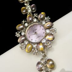 I love dual purpose jewelry. This lovely watch is also a beautiful bracelet with gorgeous lavender and pale green art glass stones. Chunky Watch Statement Bracelet Lavender Green Art Glass Rhinestones 8 in Large. $69.95 from http://stores.ebay.com/My-Classic-Jewelry-Shop :)