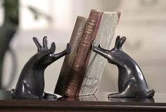 saw these in person at Hearst Castle book store and they were so adorable. Rabbit Pushing Books Bookends - Set of 2 - Rabbit Bookends - Cast Iron Bookends - Decorative Bookends   HomeDecorators.com