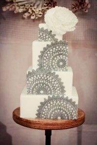 Beautiful color variant gray lace decor on square 4 tier wedding cake