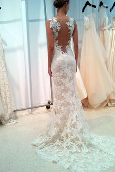 """Amsale also showed lace with the subtlest pop of color in the lining. """"Flesh, buff, mocha -- every designer calls their colors something different."""" The effect is undeniably sexy; this isn't your grandmother's lace wedding gown."""