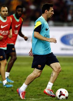 Lionel Messi of Barcelona FC dribbles the ball during Barcelona FC training session at Bukit Jalil National Stadium on August 9, 2013 in Kuala Lumpur, Malaysia.
