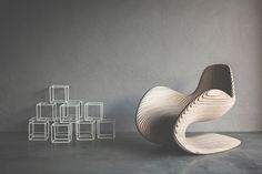 Modern Betula Chair by Apical Reform | This chair has a sinuous structure made entirely out of birch ply, is an example of fluid deconstructivism that is pleasing aesthetically and comforting ergonomically.