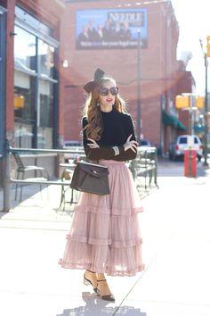 Pink Frills- Enchanting Elegance. Black Frill Sweater || Pink Tiered Tulle Skirt || Black Sparkle Heels || Bow Headband || Freyrs Sunglasses || Bauble Bar Bracelet Set c/o || Bauble Bar Star Drop Earrings c/o || Bauble Bar Rock Ring c/o || Similar Black Bag || Fashion Blogger