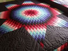 Lone Star Quilt Pattern over a black background