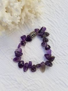 Simply Stated Polished Amethyst Gemstone Bracelet With Staggered Placement Jewelry Crafts, Jewelry Bracelets, Jewelery, Amethyst Earrings, Amethyst Gemstone, Celtic Knot Necklace, Gemstones, Trending Outfits, Unique Jewelry