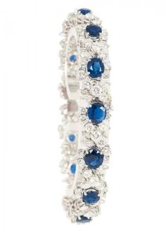 A highcarat, fine sapphire diamond bracelet  18 ct. white gold, marked. Fine setting of high brilliance with 91 diam. in round cut dand 52 navette diam. in total approx. over 8 ct. G-H.vvsi-P. and with 13 oval cut sapphires in total approx. over 10 ct. (approx. 5,7 to 6,9 x 4,8 to 6,2 mm). W. 11 mm, l. 18 cm, weight approx. 30 g AUKTIONSHAUS STAHL, HAMBURG - ALLEMAGNE Estimation 4.800€