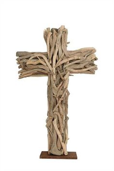 This Driftwood Cross with Wood Base has a natural appeal. With it's light natural aesthetic, this wooden cross will look at home whether your address is inland or coastal. Color: Brown Material: Drift