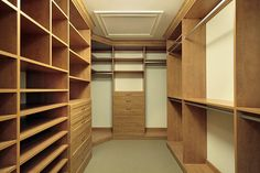 Walk in closet with shoes shelving and chest of drawers