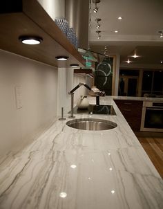 Polished fantasy brown quartzite kitchen counters and for Lineal foot counter