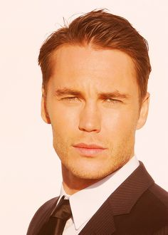"""Taylor Kitsch: Gatsby """"His tanned skin was drawn attractively tight on his face and his short hair looked as though it were trimmed every day."""" (F. Scott Fitzgerald pg 50) Taylor Kinsch has achieved the physical characteristics required to play the role of Gatsby, such as his youthful appearence, short hair, and facial matchup."""