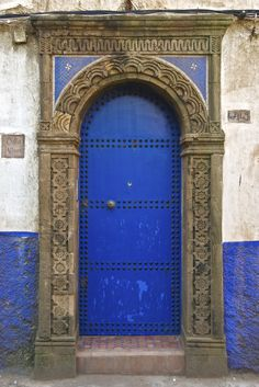 Blue door with carved stone surround, Essaouira, Morocco