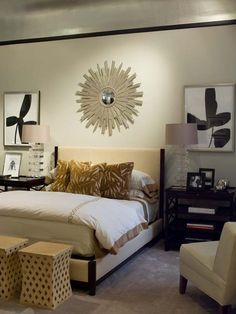 I like the cream color wall theme. Furniture color is black with gold and ,metallic accents.