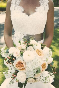 We love the colors in this bouquet!  Photo by Shinano. #MinneapolisWeddingFlorists #WeddingFlowers