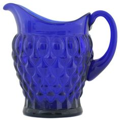 Elizabeth Pitcher Cobalt 72 oz: This vibrant hand pressed American glass pitcher is great for not only serving up your favorite drinks, but it makes a great centerpiece and flower vase.