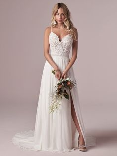 Lorraine by Rebecca Ingram Chiffon wedding gown with a slit. V-neck and back with spaghetti straps.