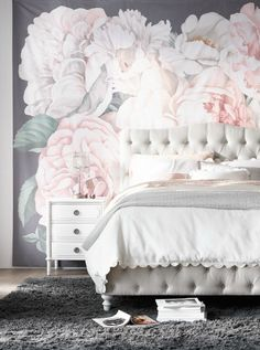 19th-century-inspired tufted bed with floral wall décor bring a room into full bloom.