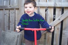 Little Daniel wears a round necked sweater in deep blue with a  slight fleck running through. THIS ITEM IS NOW SOLD