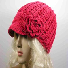 Pink fuchsia crochet beanie hat with side flower accent designed in Italy. Soft and warm with...