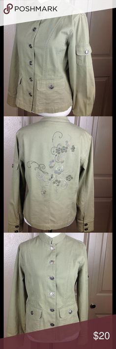 Chico's Jacket Small 0 Embroidered Floral Back Great condition green silver tone button up 2 front button pockets and arm button pocket 2 button cuffs floral back embroidery 97/3 cotton/spandex machine wash 22 inch length 19 across bust Chico's Jackets & Coats