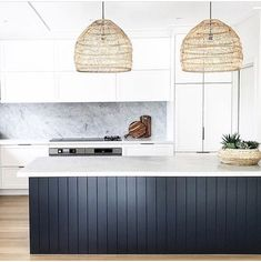 Vertical paneled navy kitchen island