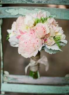 Wedding brides bouquet. Gorgeous roses and peony flowers in light pink and then the flashes of green foliage! I love this!!❤️
