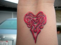 Tattoos; Red Celtic heart