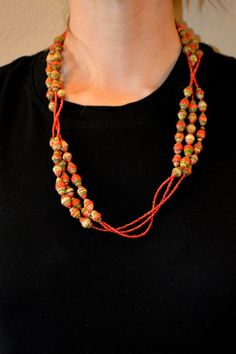 This handmade African necklace is perfect for adding an international and unique touch to any outfit. This ...
