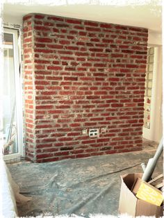 The brick wall is done.. Yes it is real brick not an imitation..  still wet and still very dark colored.. should be much more lighter when it's dry and we will spray it with special emulsion so it gets even more lighter colored and gets protective layer and can be cleaned normally afterward ..