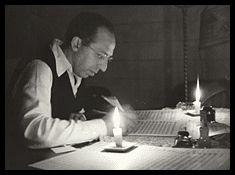 Aaron Copland by candlelight, studio in the Berkshires — Victor Kraft (September, 1946)