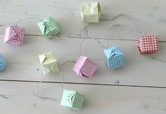 DIY: origami fairy lights instructions are in German, but there are pictures! Diy Origami, Origami Garland, Origami Folding, Origami Paper, Diy Paper, Paper Crafts, Origami Lights, Origami Boxes, Cardboard Crafts