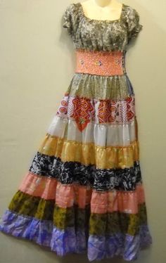I just bought (and am delighted with) this dress.  The colors are much more vibrant and lovely than in the photo.