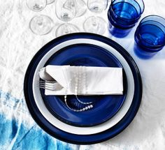 Get a table by the sea. Dinner party ocean inspired with paper pendant lamps and tableware in blue and white.