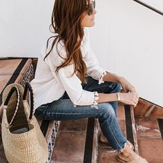 Pair frayed denim and white blouse for a classic fix.