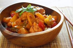 Thai Chicken and Pineapple Stir Fry Recipe Main Dishes with boneless skinless chicken breasts, fish sauce, corn starch, oil, minced garlic, minced ginger, bell pepper, red chili peppers, pineapple chunks, sweet chili sauce, cilantro leaves