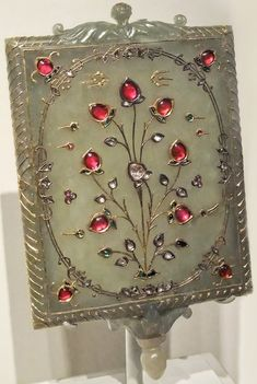 Mirror frame with Tree of Life Motif, India Mughal period 17th-18th century. Nephrite jade gold rubies emeralds and diamonds inset in the kundan technique.