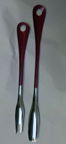 "Stainless Steel Spoon and Fork   by Bonny Products   Made in Japan   Color: Purplish Pink   Measures: Spoon 10"", Fork 8 1/2""    Condition: Very Good. at has no bends, no holes, some light scratches, no rust, and no stains."