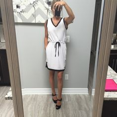   HP   ADAM LIPPES WILBLEDON DRESS Beautiful silk dress. Double layered. Black piping. Perfect for the hamptons. Never worn but I took the tags off. Size is medium but with draw string, it can fit many sizes. Small- medium Adam Dresses