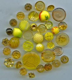 SOLD: Yellow and gold brown color glass buttons vintage buttons
