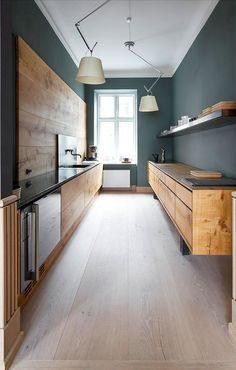 Design | Modern Oak Kitchen Dark green walls, oak cabinets, dark countertop