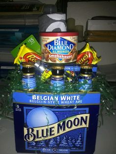 Easter basket for the husband... for the guy who's not a fan of sugar: cologne, gum, iTunes gc, tshirt, almonds & beer