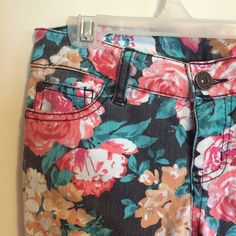 Floral Jeans These floral jeans would be a great statement piece in your wardrobe. They look great worn with a simple, solid top. In very good condition. The pockets are real! Tinseltown Denim Couture Jeans Skinny
