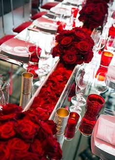 857f752eed6 Table runners were created out of a seemingly endless array of alternating  red rose petals and