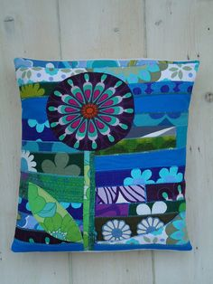 lolly flower applique / patchwork cushion featuring Marimekko and similar Scandinavian style printed fabric.