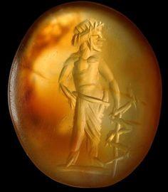 Aesculapius, carnelian hazelnut, second century A.D. Modena, Galleria Estense.