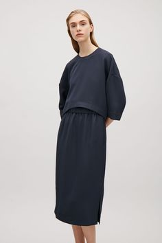 COS Layered Mid-length Dress $125. Minimalist business casual style outfit
