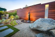 This Los Angeles rock garden by Warwick Hunt exudes a strong Zen vibe. It's filled with drought-tolerant succulents and includes an attractive water feature backed by an ipe wood screen.